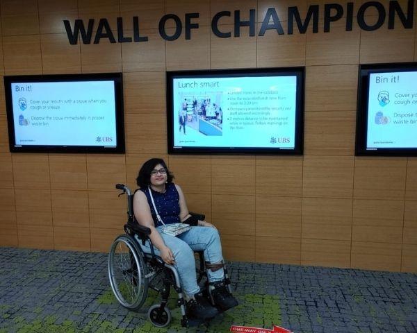 hasitha illa sitting on a wheelchair
