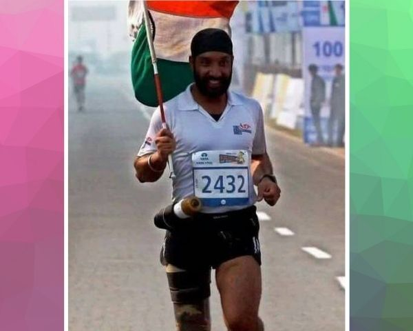Major Dp Singh running a marathon holding the India flag