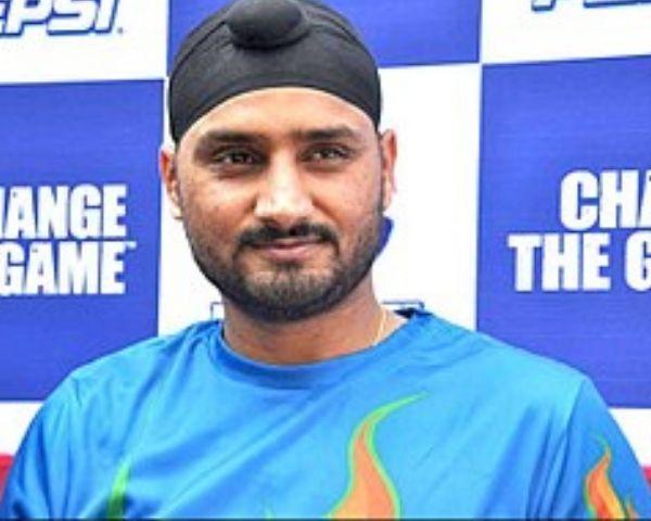 Harbhajan Singh is wearing a blue T shirt