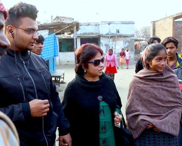 Dr Sangeeta Agrawal is wearing a green kurta and dark glasses