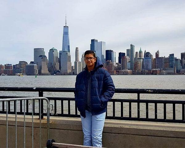 Mudit Surana is standing in front of a bridge