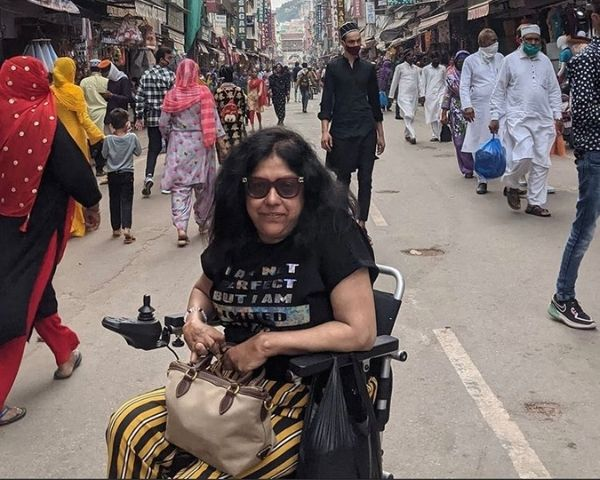 Parwinder Chawla on a wheelchair on a crowded street