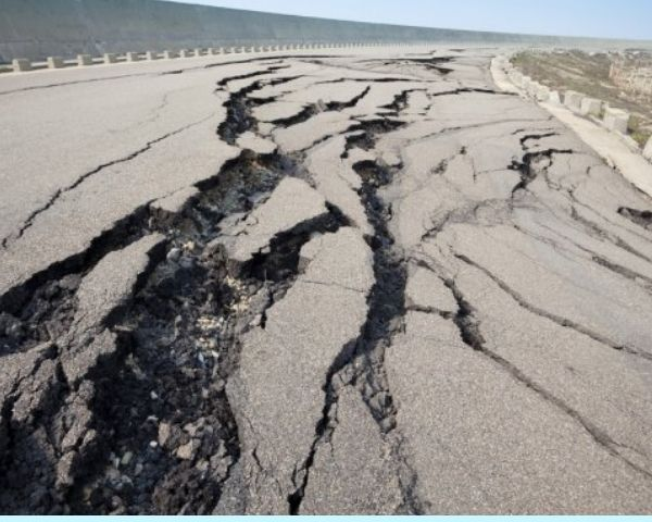 Image of a road cracked by an earthquake