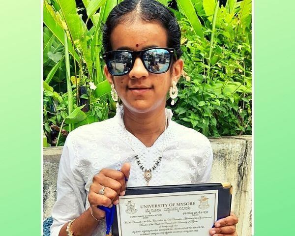 Kavya Bhatt is holding her MA certificate