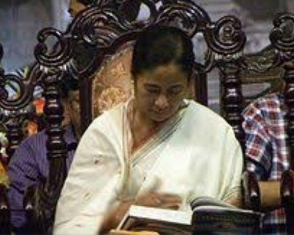 Mamata Banerjee is looking down iin this image