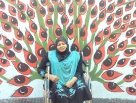 Image of salma tirur on wheelchair