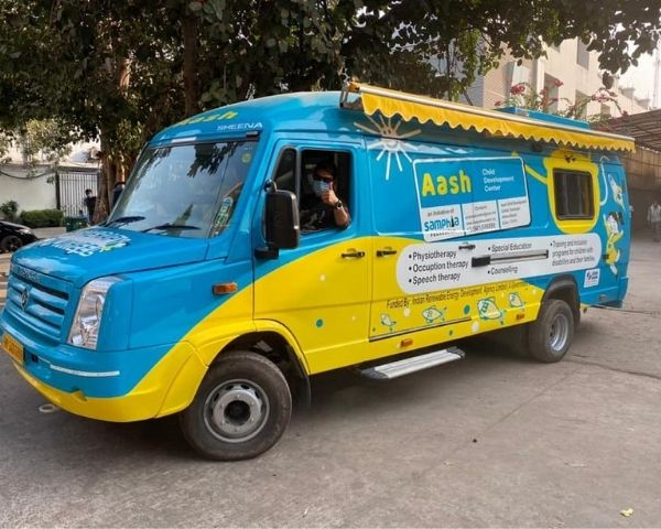 Blue and yellow mobile van launched by Aash