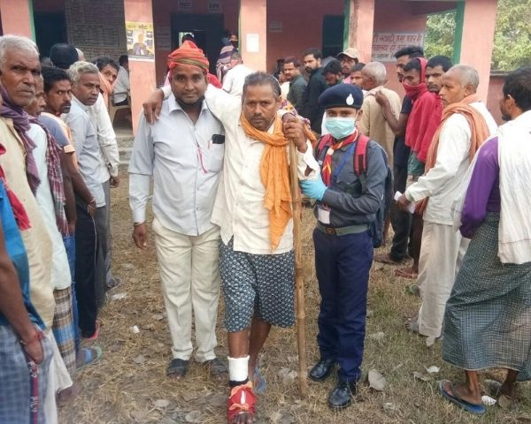 A voter with crutches outside a polling booth in Bihar