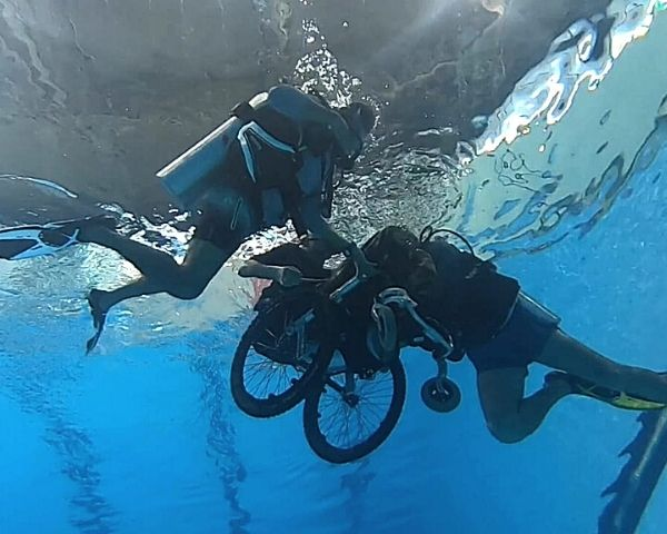 Person in a wheelchair going scuba diving.