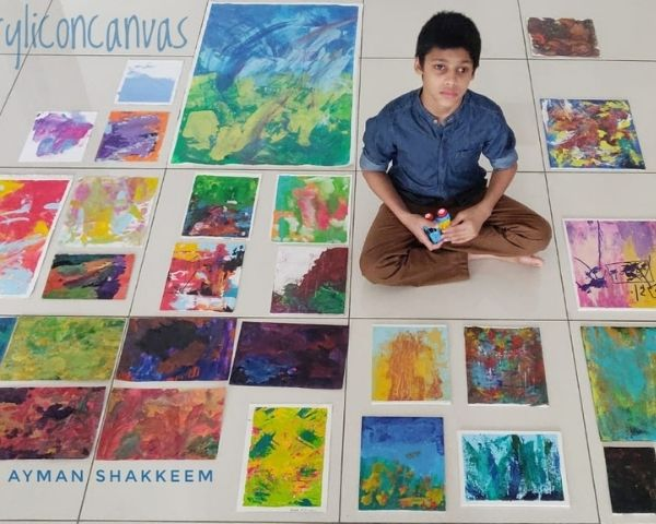 ayman shakeem with paintings