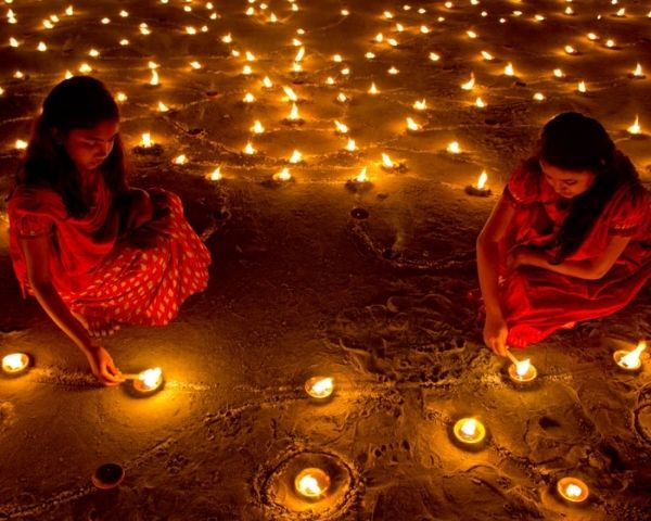 children lighting diyas