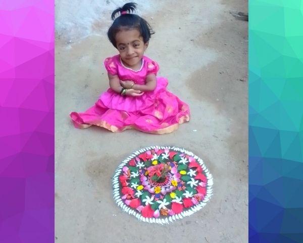 Girl with brittle bone disease sitting on floor