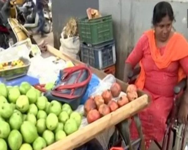 Image of disabled woman selling fruits