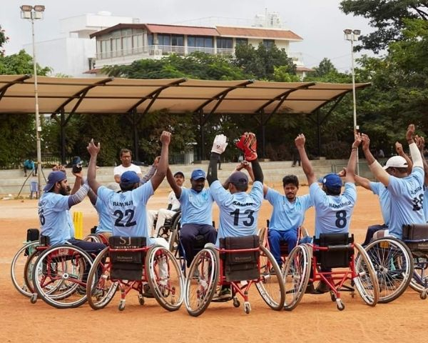 wheelchair cricketers sitting in circle