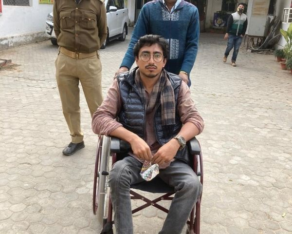 Harsh Raj is seated in a wheelchair