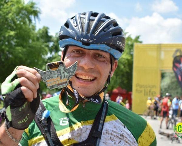 Para-cyclist Attila Oláh holds hid medal