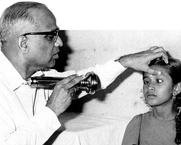 Doctor testing a child's eyes