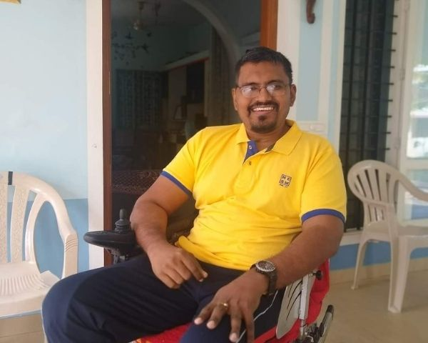 vijay kumar nair sitting on wheelchair