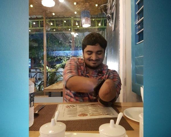 image of vivek in a restaurant