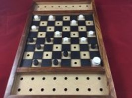 A checker game set with raised tactile markings.