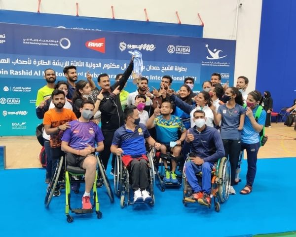Members of the Indian para badminton team celebrating win