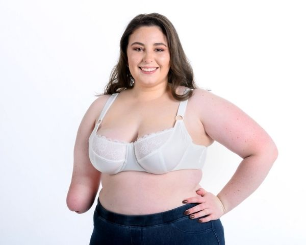 Model with one hand wearing the BraEasy bra