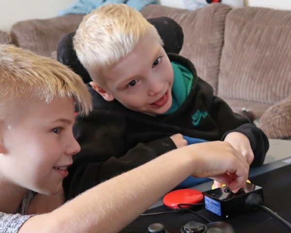 Two young boys playing a video game
