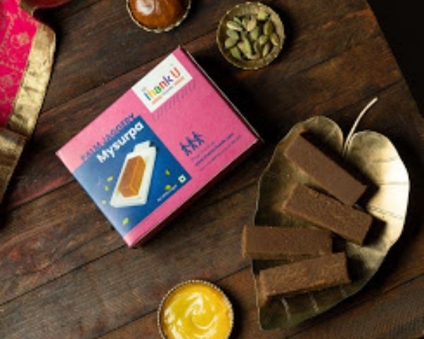 A box of Mysore Pak with Thank U Foods on the cover