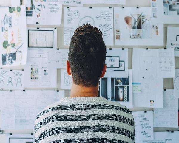 a man looking at the mindmaps